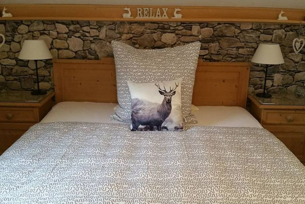 Bedroom shown made up for single guest