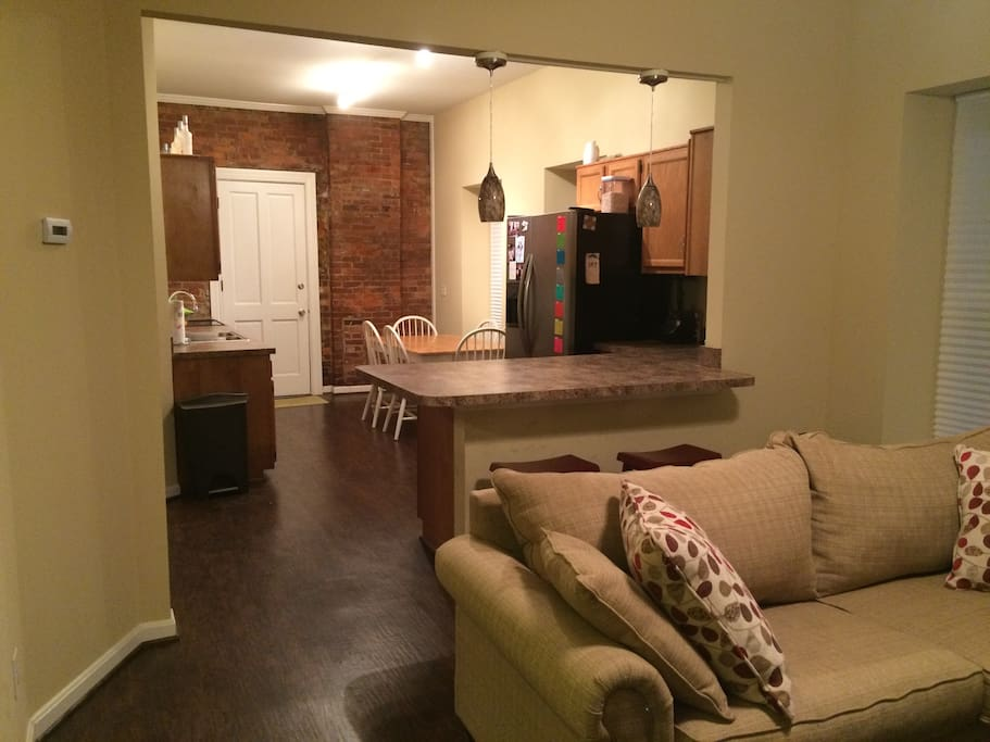 Kitchen, Kitchen Bar, and living room
