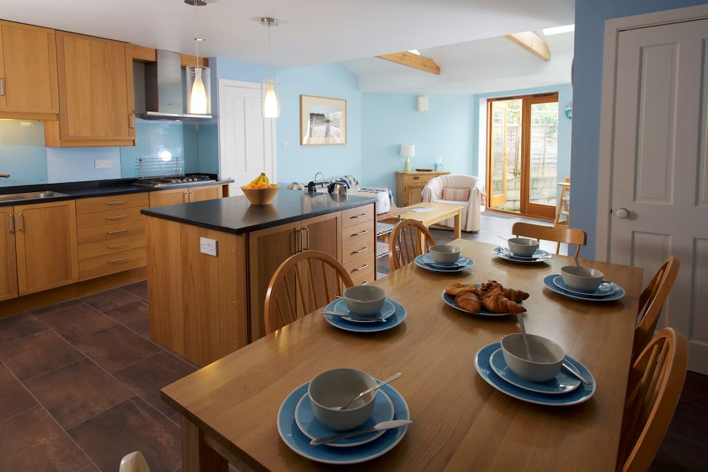 Fully equipped kitchen/diner with seating area leading to large garden