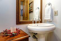 A convenient powder room is located just down the steps from the main floor.