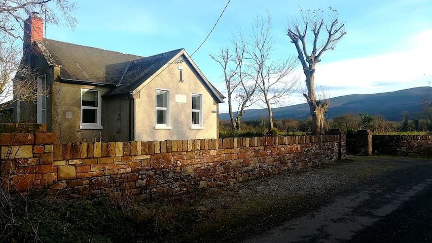 The Old Schoolhouse set in the Glen of Aherlow