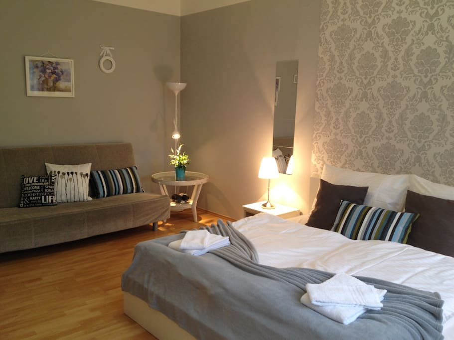 The second bedroom is quite room with comfortable king-size double bed, pull-out sofa bed, wardrobe, desk.