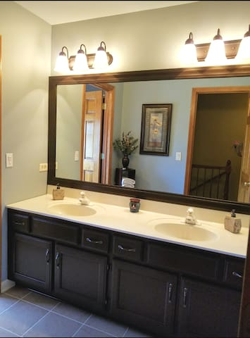 Shared bathroom with separate shower & toilet area.