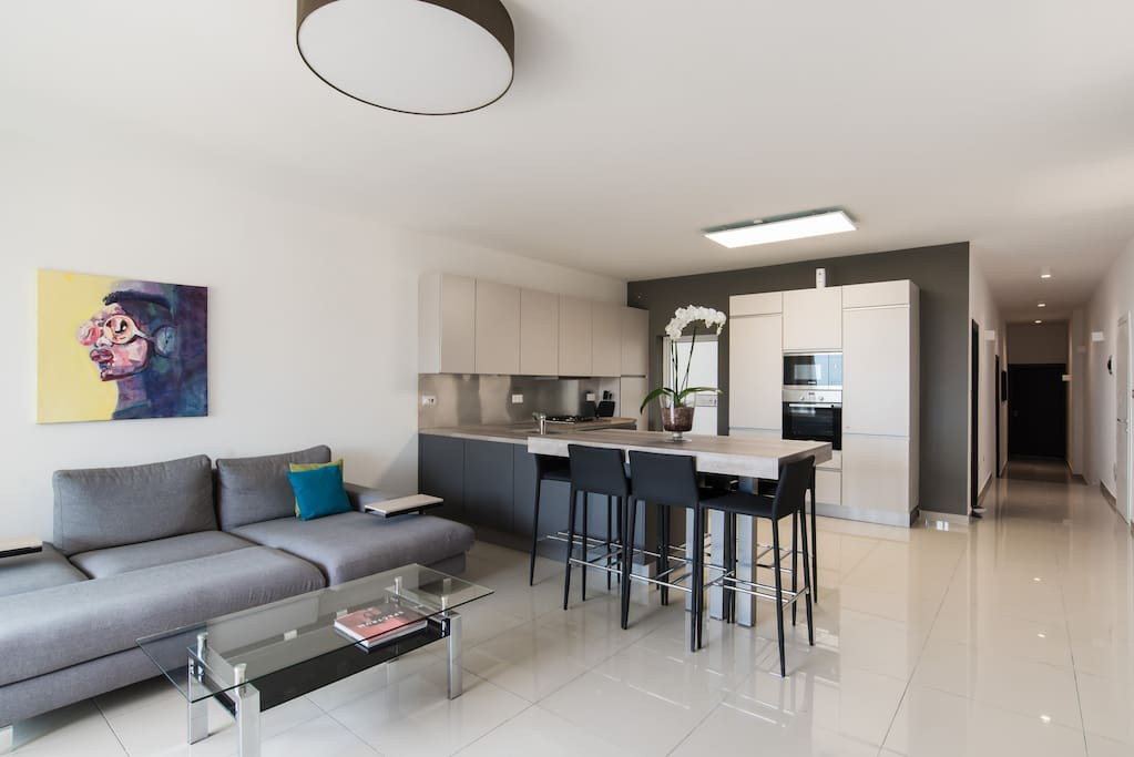Open Plan Kitchen Living Dining Area, leading onto balcony.