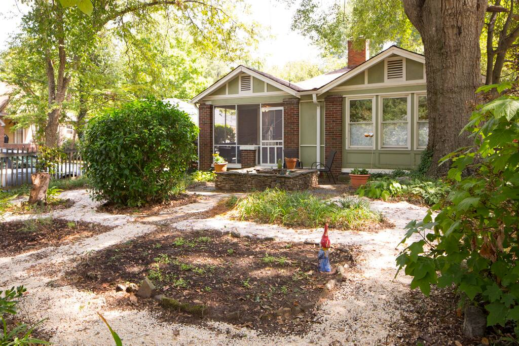 An enclosed front yard includes a small herb garden.