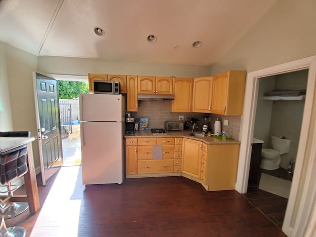 Nice kitchen to cook while staying making snack has stove oven coffee maker and microwave oven large refrigerator save lots of money cooking or making snacks while you enjoy your stay in Los Angeles
