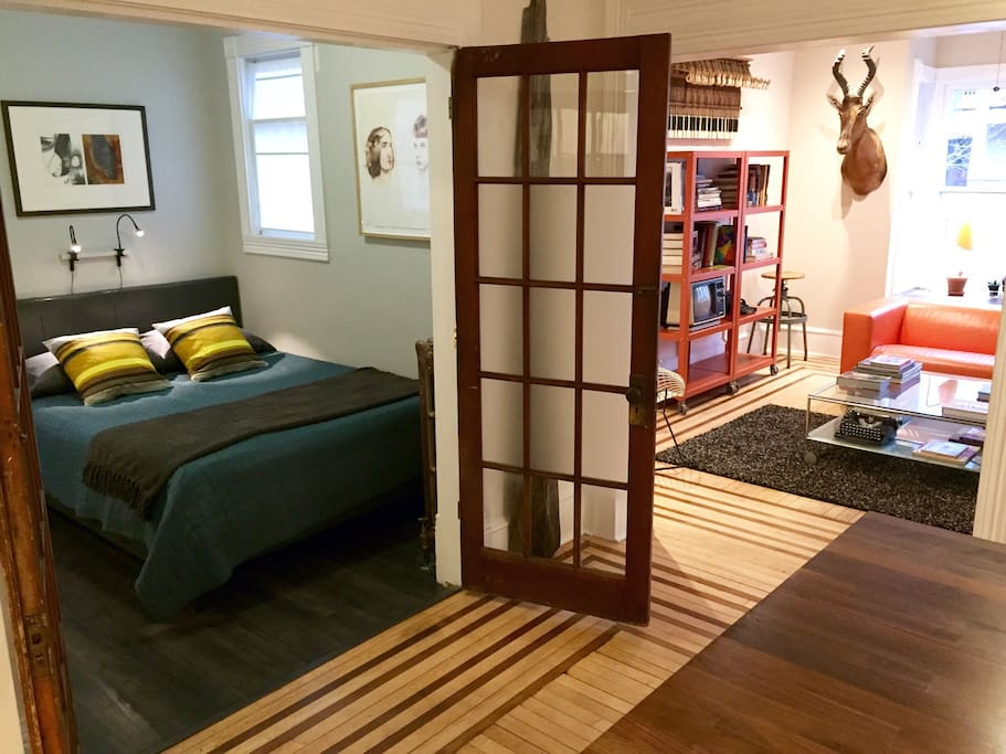 Bedroom has french doors that open up into kitchen.