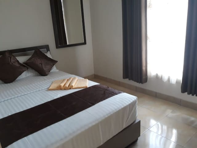 Premium Room at Nadika Guest House Syariah