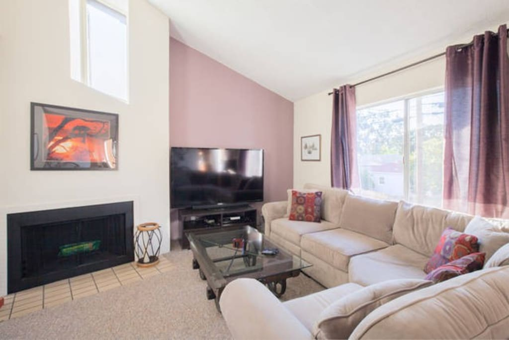 """73"""" TV and working wood fireplace"""
