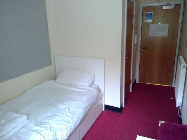 Self contained en suite room with parking