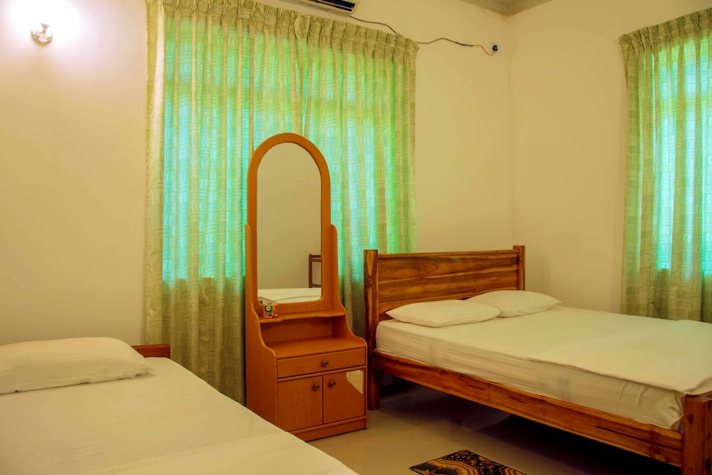 Luxury double bed and a single bed room with air conditioning.
