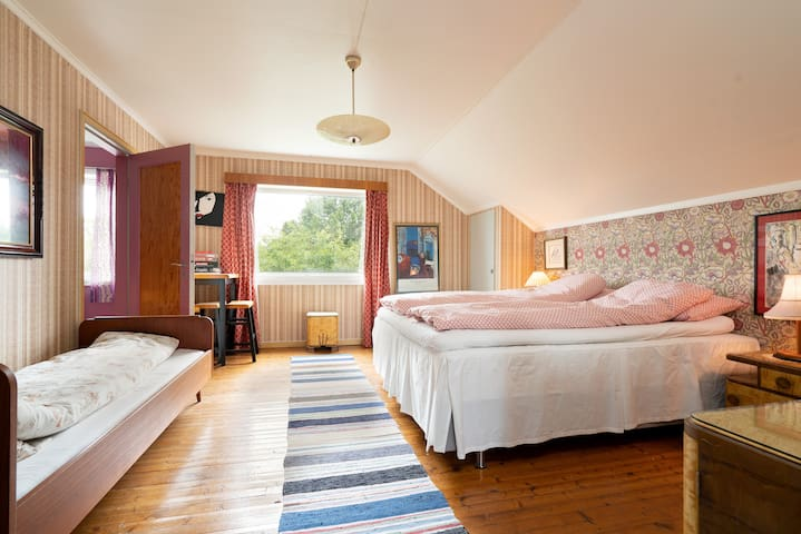 Bedroom 3: One double bed and a single bed.