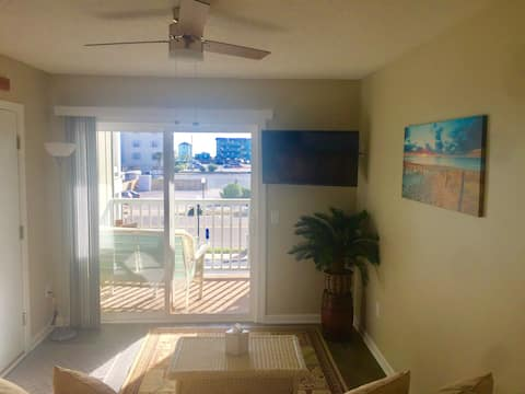 The view from  the living room couch with a peek at the ocean!