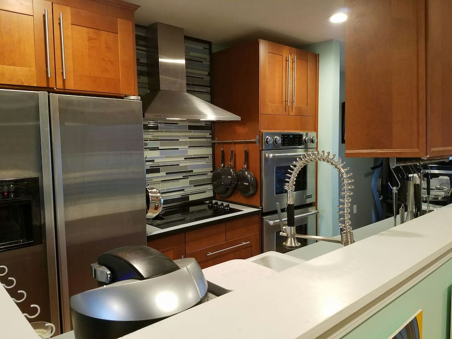Kitchen with cooktop and double convection oven.