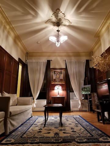 Living room night ambiance under soft chandelier lighting