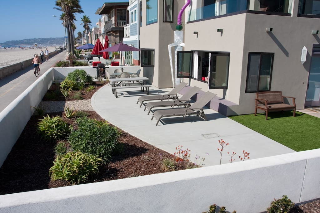 Enjoy the beach and boardwalk from a private front patio.