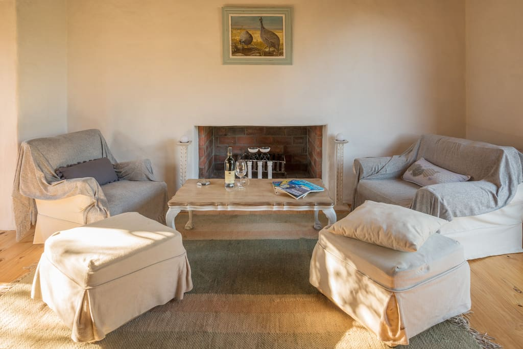 Cosy fireplace seating for winter stays