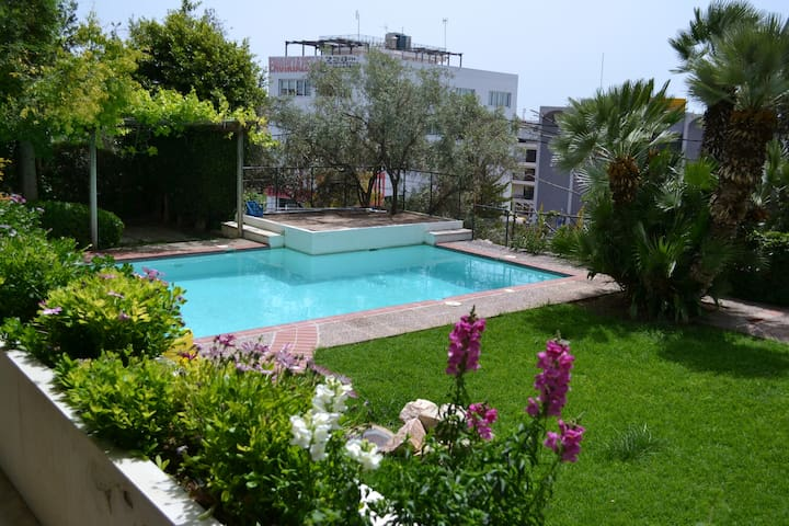 Close to the beach flat with a pool !!