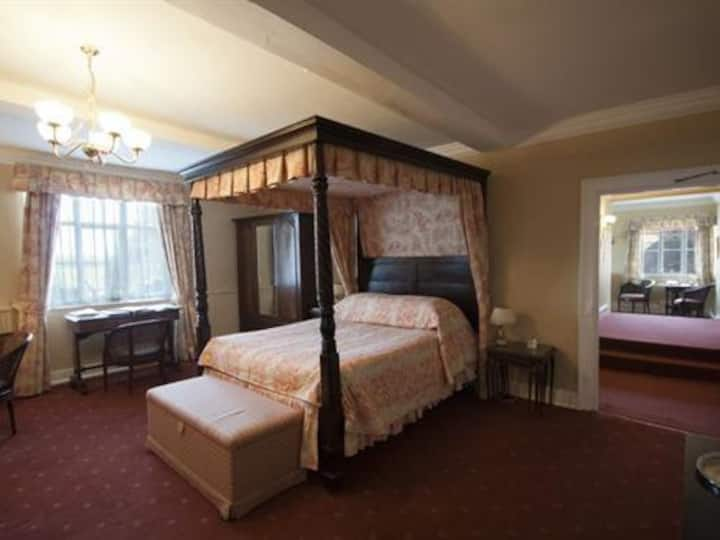 Four Poster Suite at Corse Lawn House Hotel