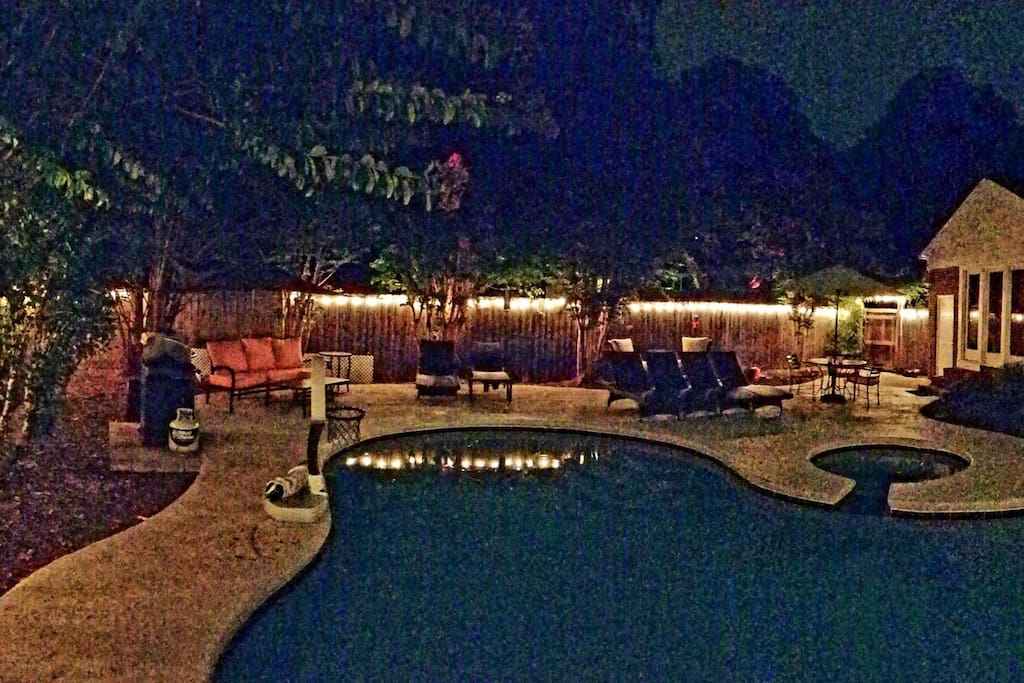 Glowing evening oasis. Including a grill, remote controlled perimeter lights. App controlled hot tub and pool lights.
