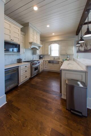 Chef's dream kitchen with Carrera Marble, Wolf, Subzero, and the fun farm sink.