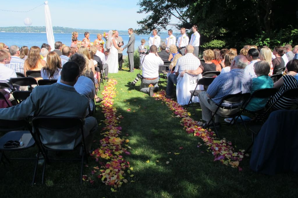 wedding on the grass with Puget sound backdrop