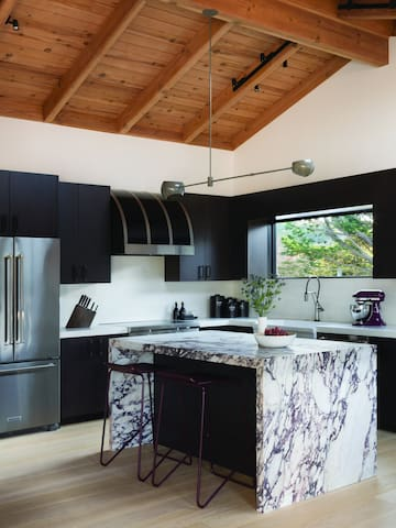 Well-appointed, gourmet kitchen with marble island