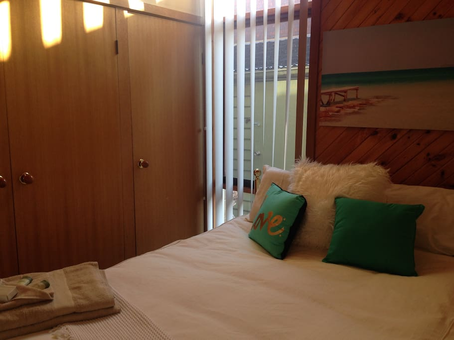 Blue Sunny Room - consist of a double wardrobe for hanging, has carpet, ceiling fan and slab heating
