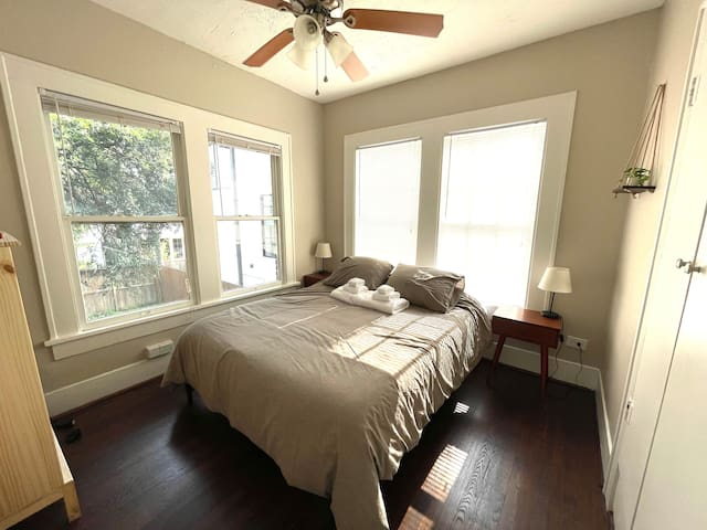 Cozy bed with cooling mattress.  Two nightstands, dresser, small closet with hangers.  Backyard and downtown views. Blackout curtains included for better sleep.