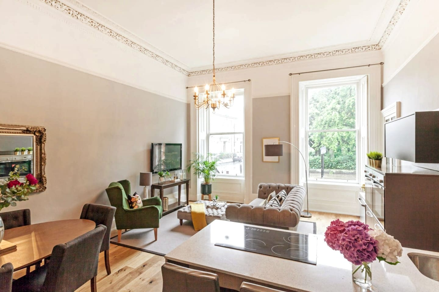 Open plan living, kitchen, dining in former Drawing Room. Grand scale and 4m (13ft) high ornate ceilings
