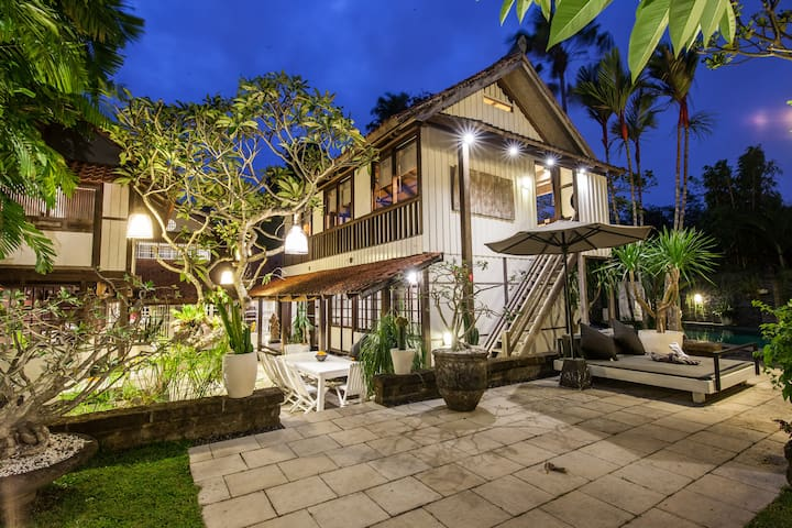 The amazing Villa Sembunyi and its 5 bedrooms, 5 bathrooms, spacious living room, fully equipped kitchen, large tropical garden with lotus pound, and private swimming pool.