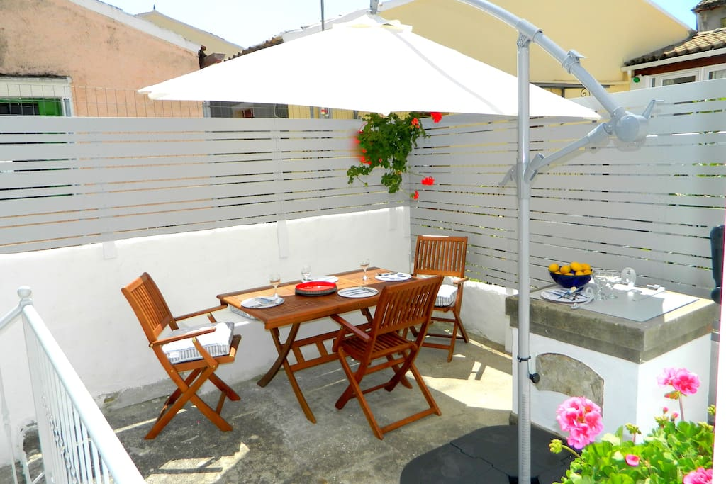 Raised sun drenched terrace for outdoor dining