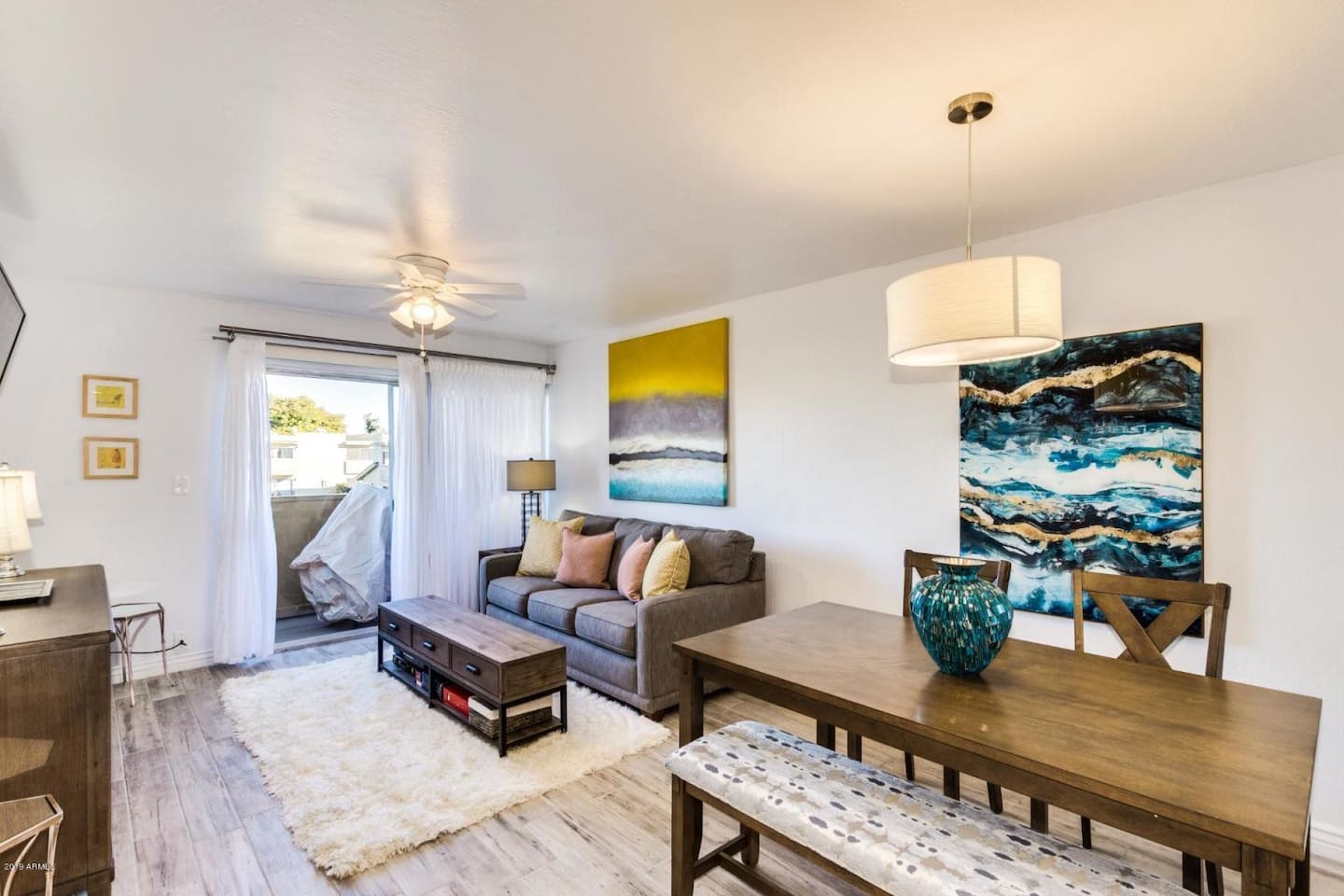 Comfortable couch with easy access to balcony with views of Camelback Mountain