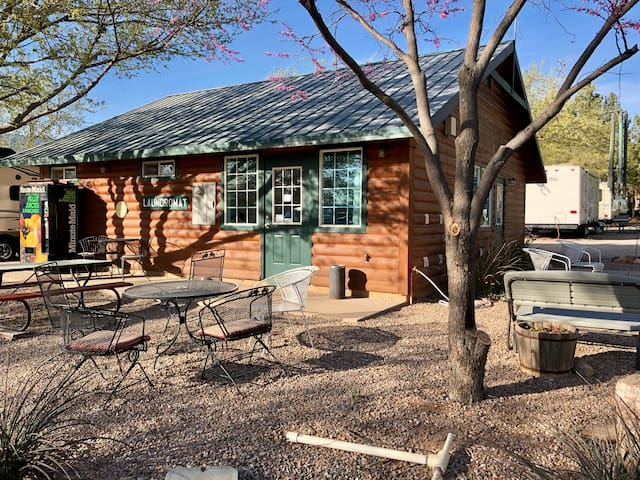 Just 30 feet from the tent: top rated clean bathrooms according to Good Sam, His and Hers hot showers, and coin op laundry room!