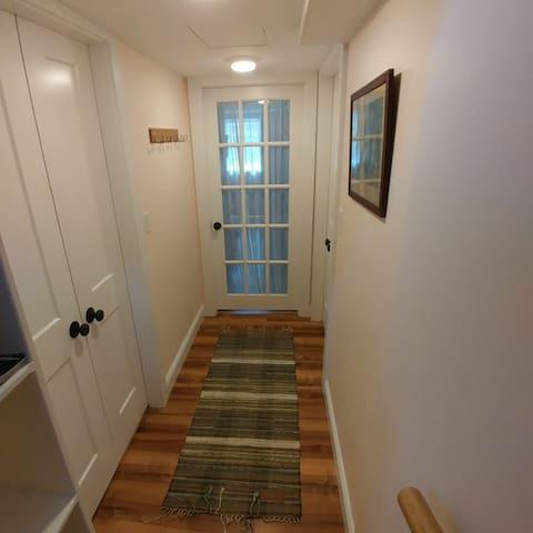 Hallway leading to the room.
