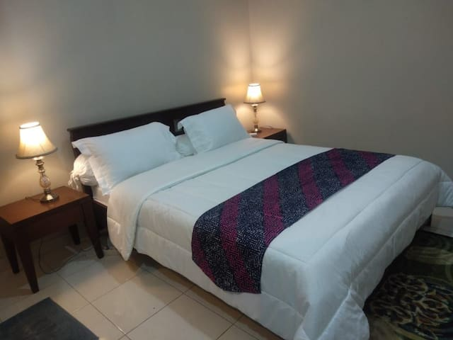 Bedroom # 2, a double bed equipped with AC & bathroom inside