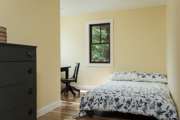2nd bedroom with double bed, desk with large window facing over the pond.  Great work space.