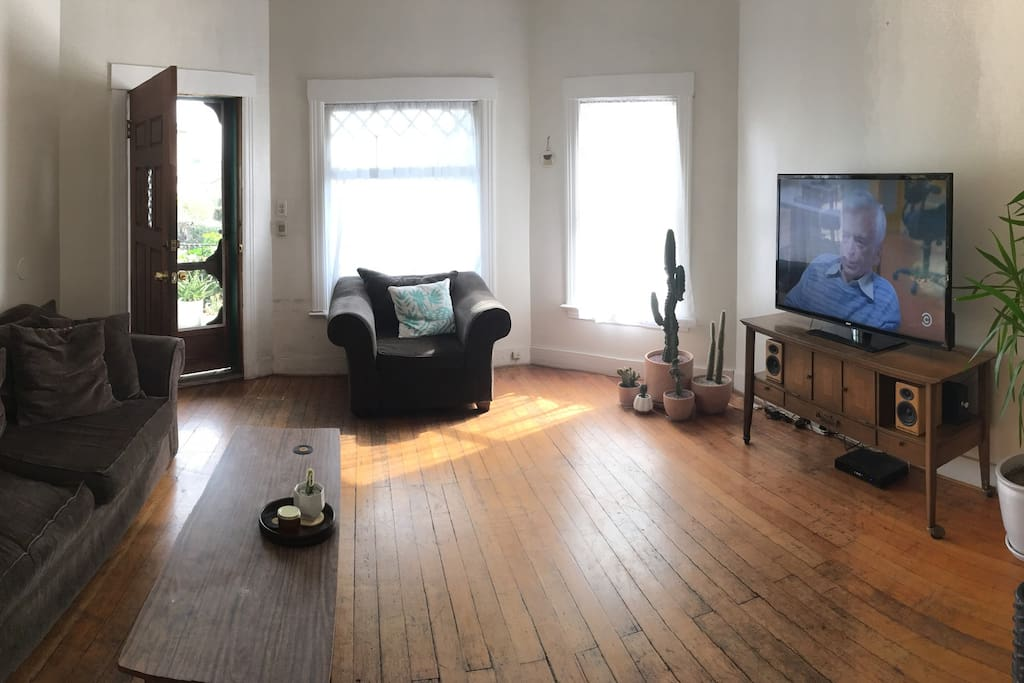 "The living room.  Lots of cacti, succulents, 52"" TV with cable."