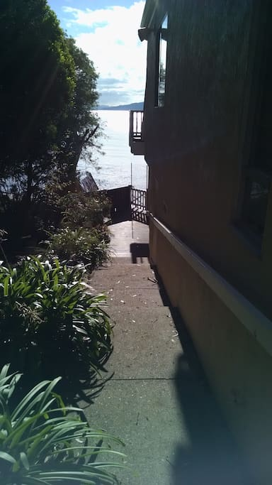 Walk down the alleytoward the water.  You enter right above the stairs to the beach terrace.