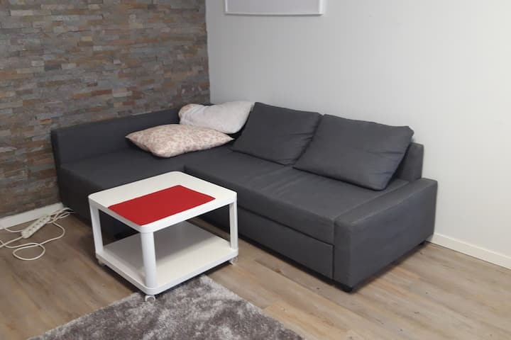 A Comfortable sofa in a served area in Myyrmäki