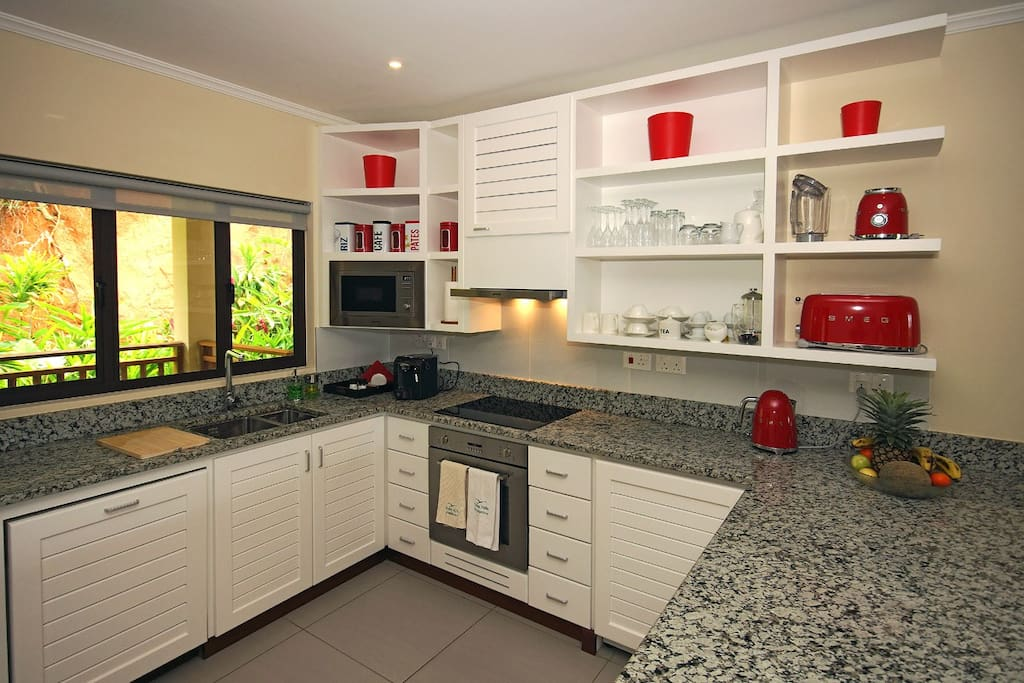 Granite counter top, toaster, blender, kettle, glasses, cups, plates & cutlery etc for 4 persons.