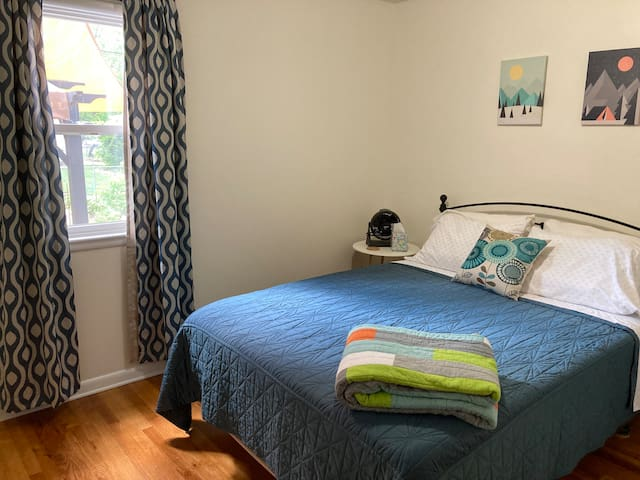 The teal bedroom has a queen bed, alarm clock, blackout curtains, and a closet with hangers and a rolling shelf unit.  The hall closet has additional pillows and extra blankets to ensure you're comfortable.