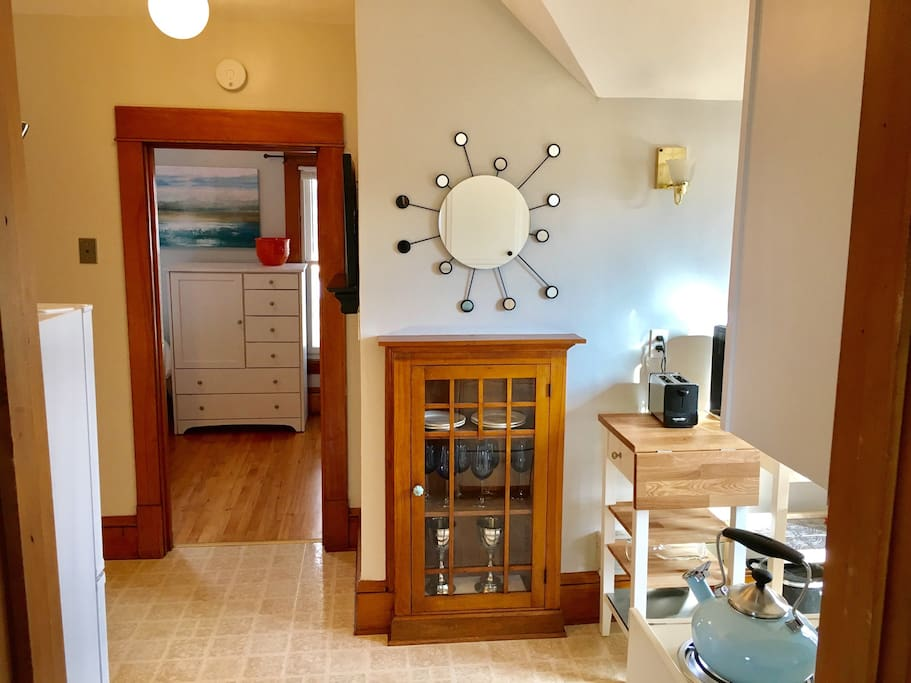 Full kitchen has a coffeemaker, toaster, microwave, stove, oven and refrigerator