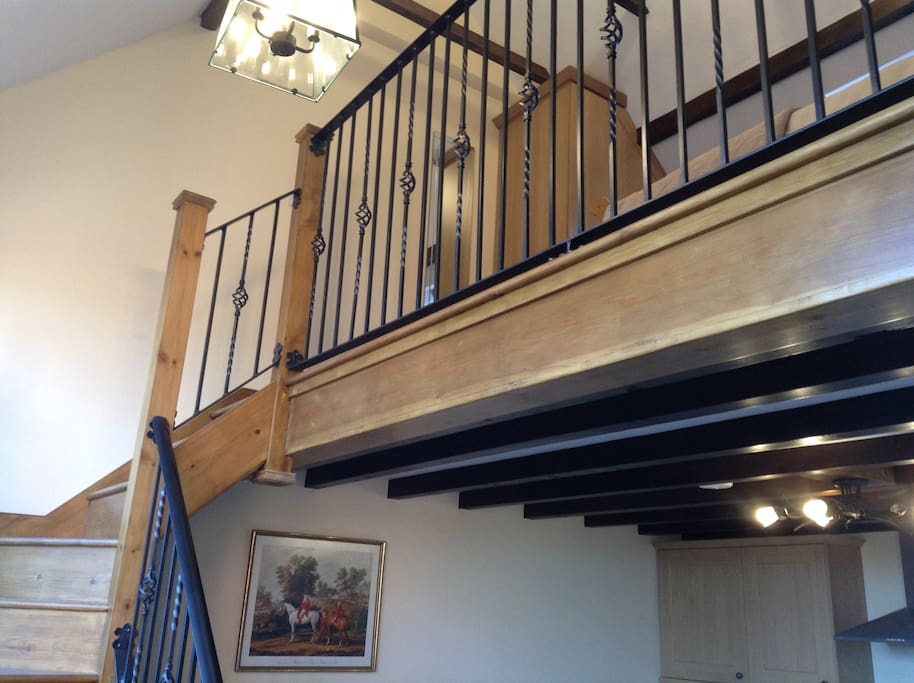 Wrought Iron staircase leading to the Bedroom on the Mezzanine level