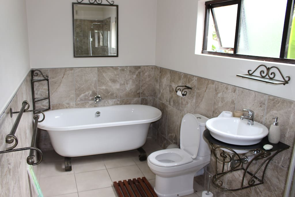 En-suite Bathroom with bath, shower and toilet
