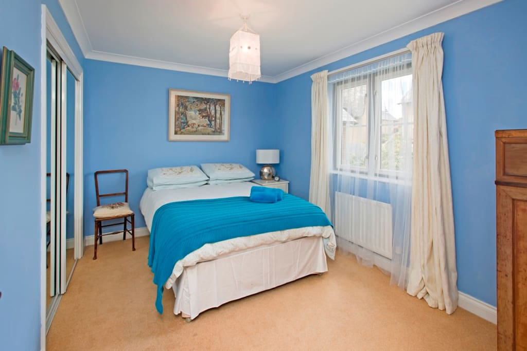 Our 'blue' guest room. Overlooks rear garden. Includes built in wardrobe.