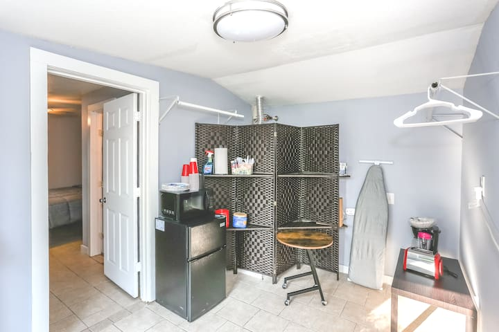 Kitchenette area with microwave, fridge, coffee and various other amenities