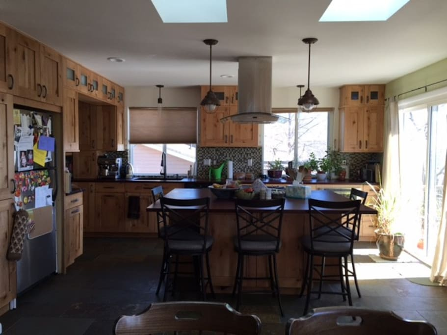 gas range/dual oven in island (seats 5). Pantry, stainless steel appliances, deck access (with gas grill)