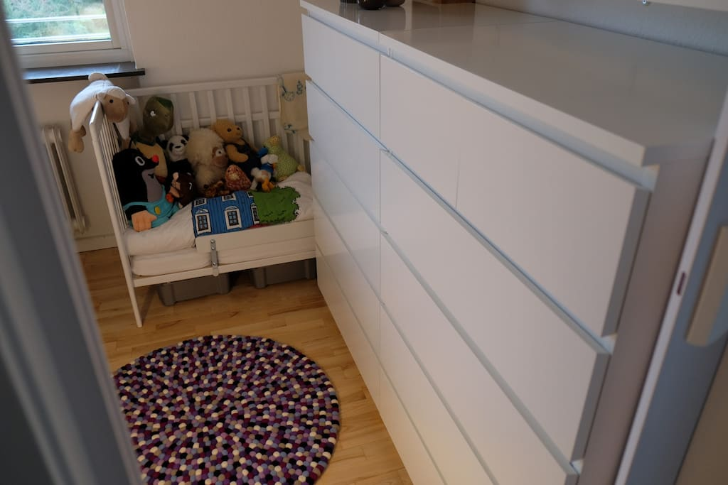 Toddler bed placed next to master bed.