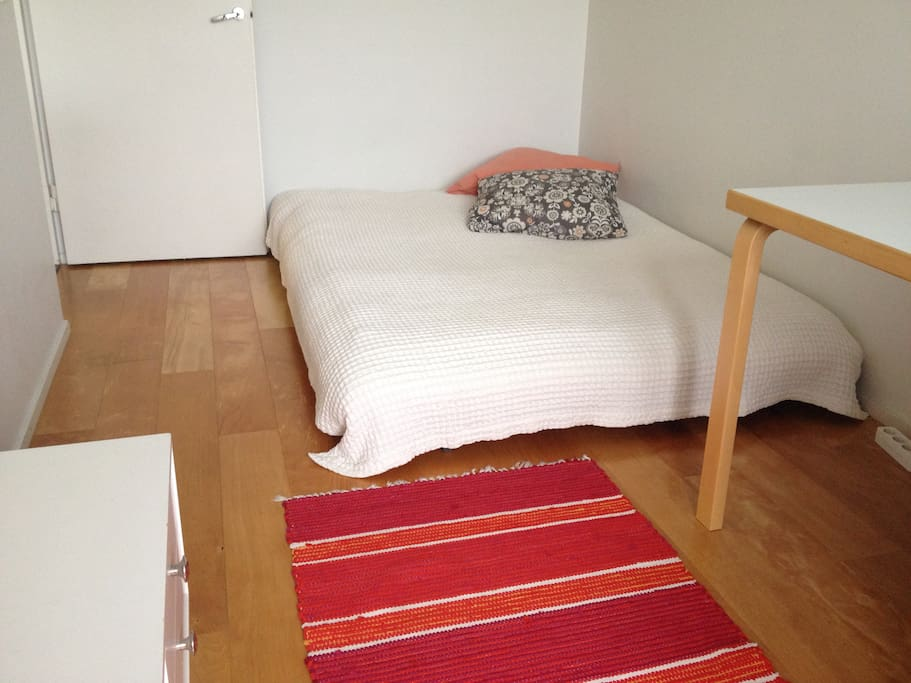 The bed is a 140cm wide futon for one or two people.
